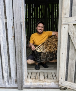 Here's Ryan placing the garlic in my old corn crib - it has good ventilation and overhead protection from any rain.