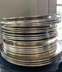 Whenever I decorate with plants, I use silver, copper, or glass plates, purchased from tag sales or antiques fairs, under the pots to catch any water. I find them more decorative than the clay saucers that come with the pots.
