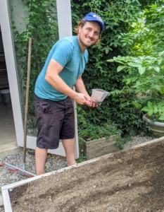 Here's Ryan at one of the raised beds. Raised bed gardening allows good drainage, prevents soil compaction, and provides protection for those plants that may otherwise get trampled.