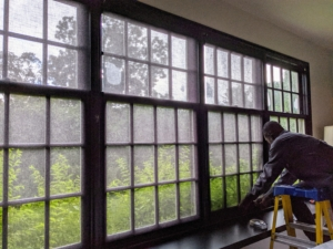 The same shades are also on this large window in the sunken living room. After each shade is installed, Tony tests the rolling tension several times to make sure it is perfect.