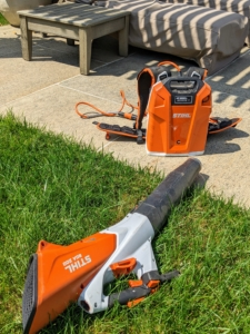 To clean the area after pruning, Brian lightly blows any cut leaves and debris with STIHL's backpack battery and handheld blower. The backpack battery eliminates the cost of fuel and engine oil and can be used for several hours before needing another charge.