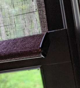 These roller shades stay down with a handsome and weighted hem bar at the bottom of each shade.