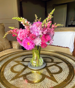 This pretty arrangement is made using asters, snapdragons, and scabiosa. Scabiosa is also known as the pincushion flower. The easy to care for plant has interesting flowers with cushion-like centers and pin-looking stamens.