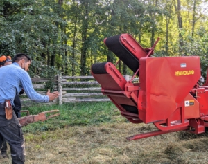 Here is Pasang guiding the baler as it is moved and positioned behind the tractor.