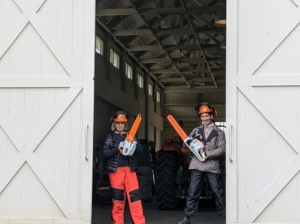 """Here I am in my STIHL chaps, helmet, and gloves along with Kevin Sharkey. Maybe you recognize this shot from my show """"Martha Stewart Gets Down and Dirty"""" on Discovery+. I am so pleased with all these tools from STIHL - they allow us to get so much work done here at the farm."""
