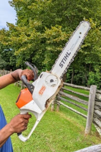 Pete likes to use STIHL's powerful battery-powered MSA 220 C chainsaw. It's capable of felling and limbing. Its durable construction and reliable performance make it a powerful addition for its size. Pete uses it to trim the tops of the upright fence posts as he replaces them.