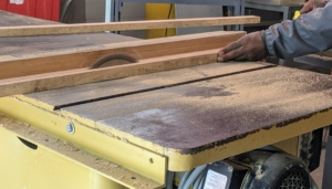 Some of the wood is made into stakes. I have a small table saw in our shop where we can cut custom stakes to support all my young, developing trees. The same table saw can cut stakes to mark the carriage roads.