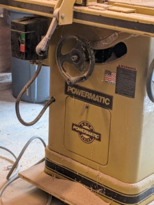 This is our Powermatic table saw. It is a rugged cabinet saw that only requires 115V of power.