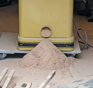 A lot of sawdust is generated during the process – thankfully, it was not a windy day.