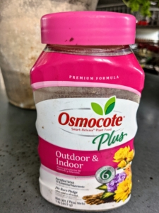 After planting, Ryan adds a sprinkling of Osmocote fertilizer – also available at Martha.com.