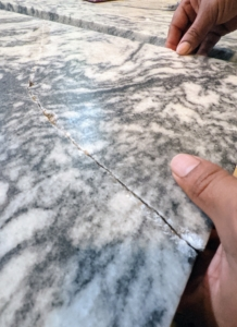 Here is another crack - this chunk was completely broken off. This marble top is a combination of marble and black granite - it is a beautiful and very valuable piece.
