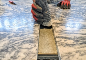 Meanwhile, the team vacuums the area of any debris - leaving both sides of the marble clean and ready for repair. It is also wiped down with acetone, the same liquid solvent used in nail polish remover.