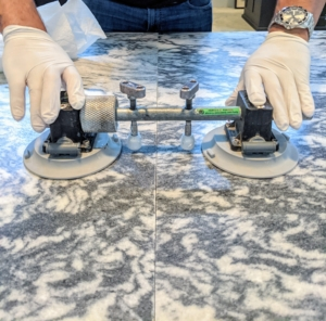 Carlos uses a heavy duty suction cup stone setter to hold the pieces together.