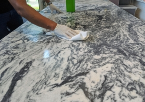 Lastly, Carlos wipes the entire table with a heavy duty exterior sealer made especially for stone.