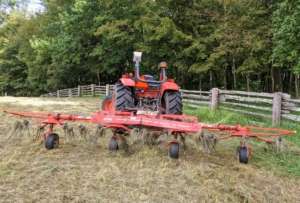 This is a hay tedder. A tedder spreads and fluffs the hay in a uniform swath after it is cut. It basically turns the hay, so it can dry completely.