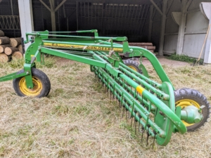 After the hay is tedded, it is then raked. Raking the hay is the fastest part of the process. There are different kinds of rakes – they include wheel rakes, rotary rakes and parallel bar or basket rakes. This is a parallel bar rake. This type uses a gentle raking action with a lower chance of soil contamination than the wheel rake.