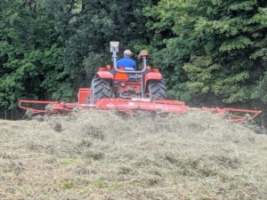 Here is another view – look how the tedder picks up and fluffs the hay with its forks.