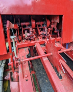 Here is the motor that helps to move and propel the bales into the wagon.