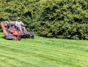 Adjacent to the pergola on one side is my expansive soccer field where my grandson, Truman, loves to play when he visits. In order to keep it in excellent condition, it must be mowed regularly. Here's Chhiring on my Kubota ZD1211-60 zero turn riding mower. It has a 24.8 horsepower diesel engine and a wide mower deck. It gets a lot of use this time of year.