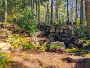 """From this location at one of the natural pools of Skylands, one can see some of """"Rockefeller's teeth"""" at the top - large, irregular blocks of granite that serve as guardrails."""