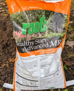 For all of these plants, we're using Roots fertilizer. Roots Healthy Start Advanced 3-4-3 is formulated especially for garden and flower beds, bulbs, potted plants, top dressing, and established and newly planted trees and shrubs. It includes beneficial rhizoshpere bacteria and mycorrhizal fungi to boost biological soil fertility.