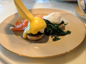 And then Chef Pierre tops the eggs with a spoonful of Hollandaise sauce - one generous spoonful over each poached egg.