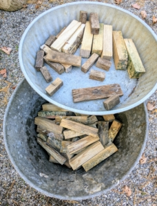 We also keep smaller scraps of wood to use as shims for under the pots - these help level the planters and allow for better drainage.